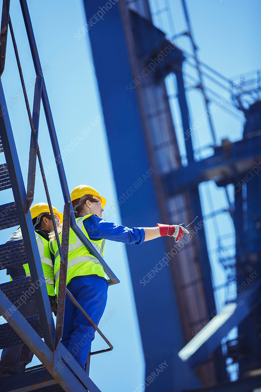 Low angle view of workers on cargo crane
