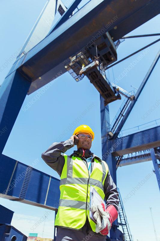 Worker talking on walkie-talkie