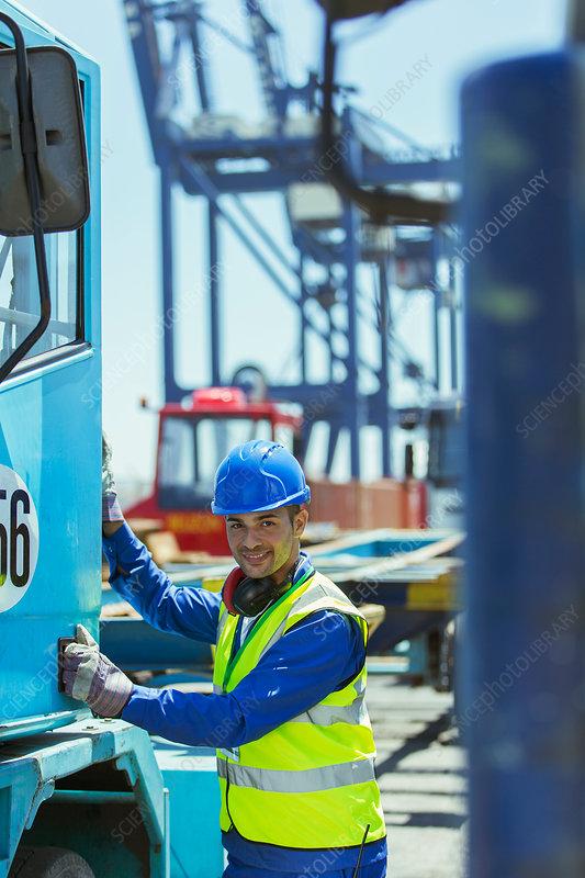 Worker climbing into truck