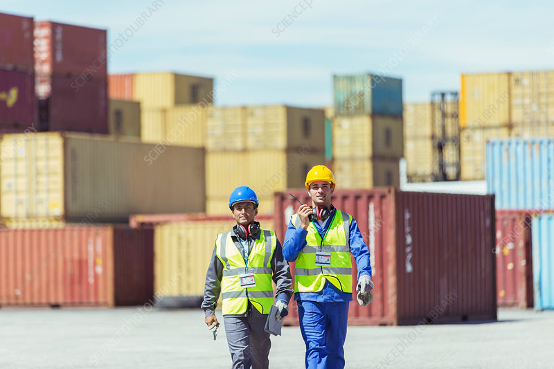 Worker and businessman walking