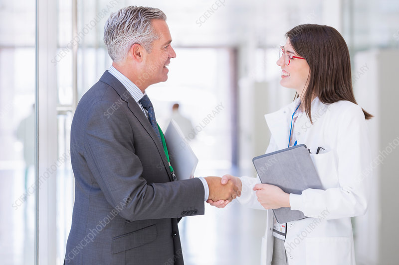 Scientist and businessman shaking hands