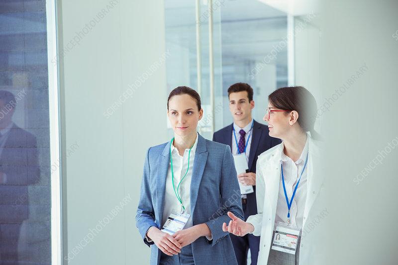 Scientist and businesswoman talking