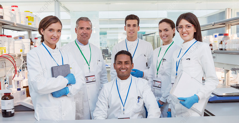 Scientists smiling in laboratory