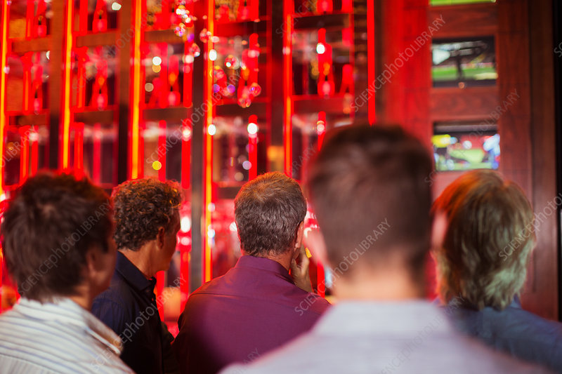 Men watching TV in bar