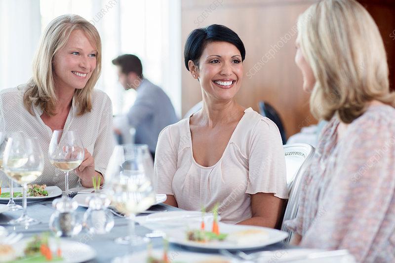Cheerful women in restaurant
