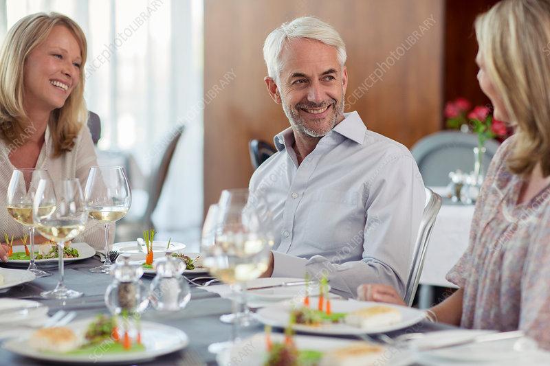 Smiling people enjoying their meal
