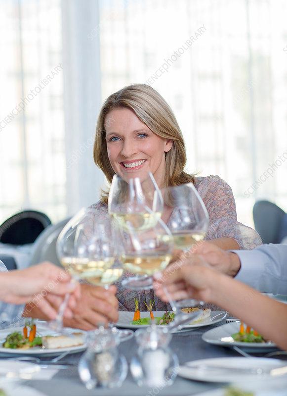 Mature woman toasting