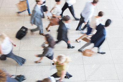 Business people walking on tiled floor