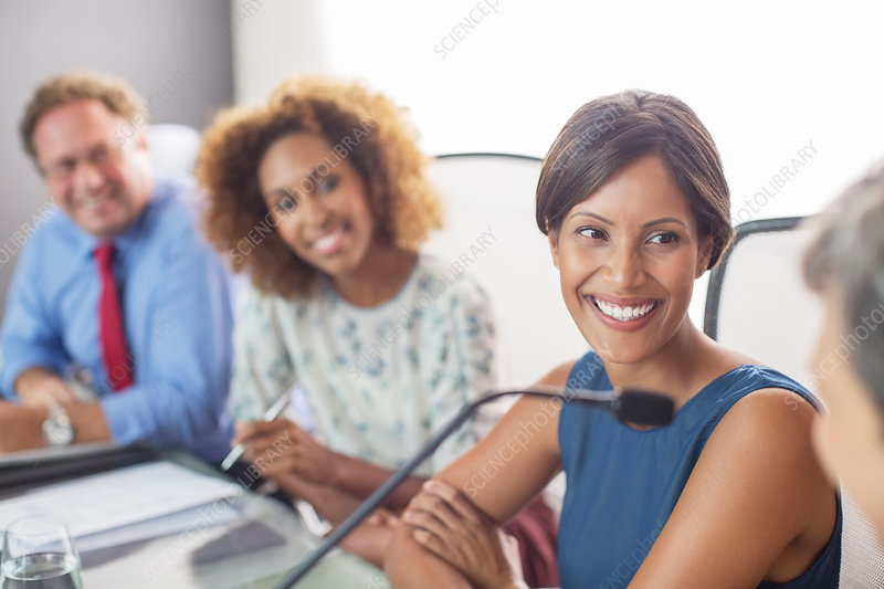 Smiling woman sitting at conference table