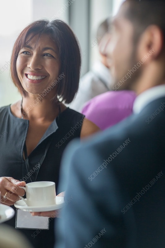 Mature woman with coffee cup