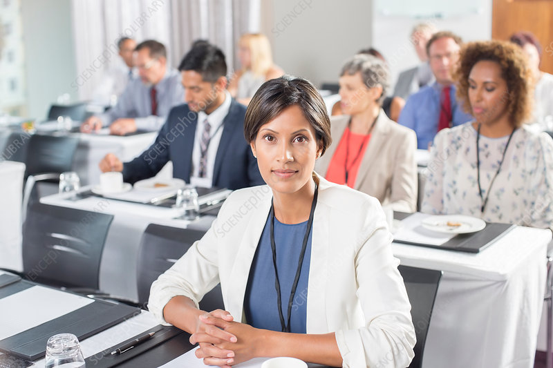 Portrait of woman with Business people