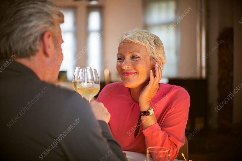 Older couple toasting each other