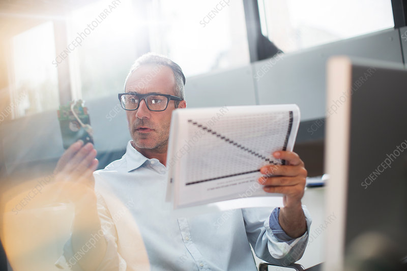 Businessman reading paperwork