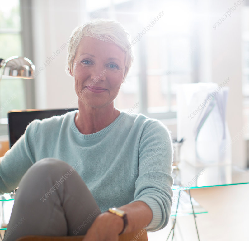 Businesswoman smiling at desk