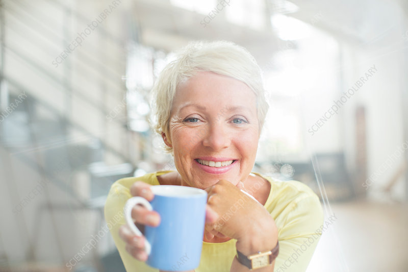 Older woman drinking cup of coffee