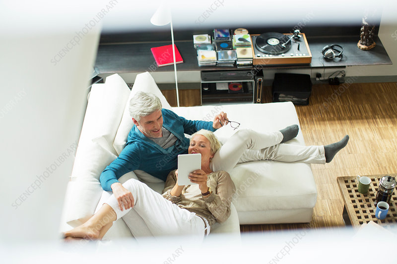 High angle view of older couple on sofa