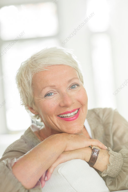 Older woman smiling on sofa