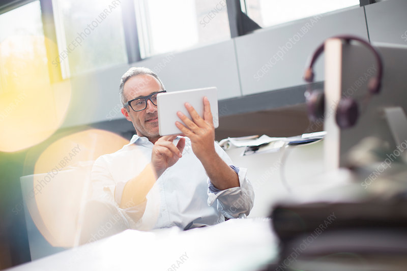 Businessman using tablet at office desk