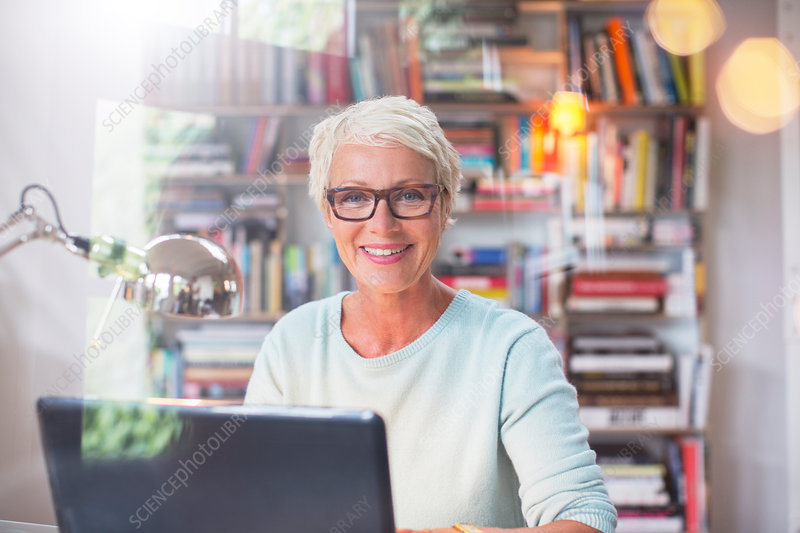 Businesswoman smiling at computer