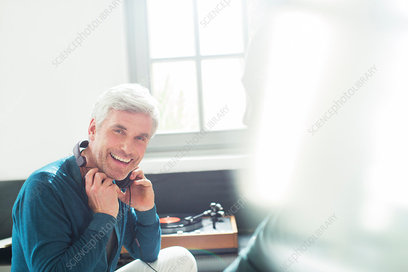 Older man with headphones