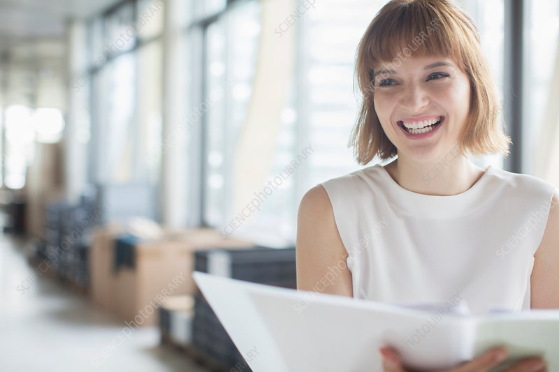 Businesswoman laughing in office