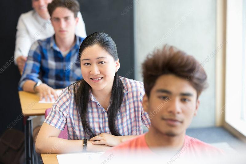 Smiling university students sitting
