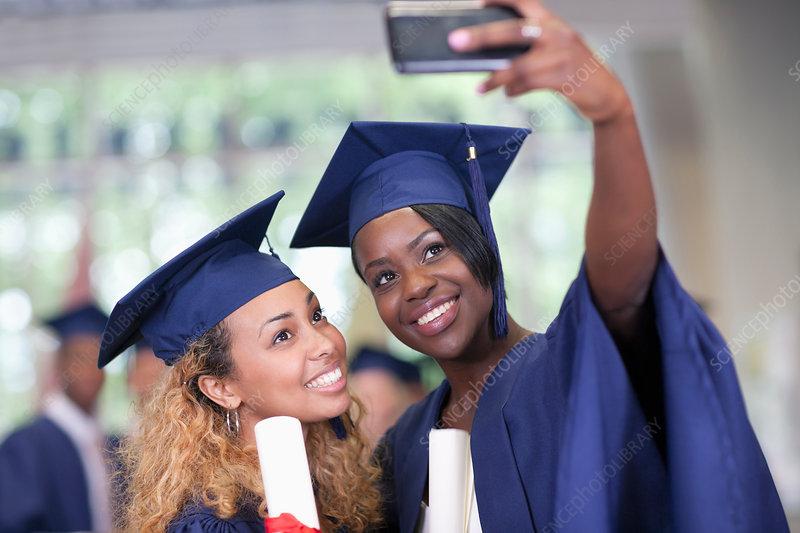 Students taking selfie after graduation