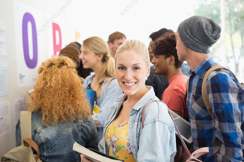 Smiling female student looking at camera