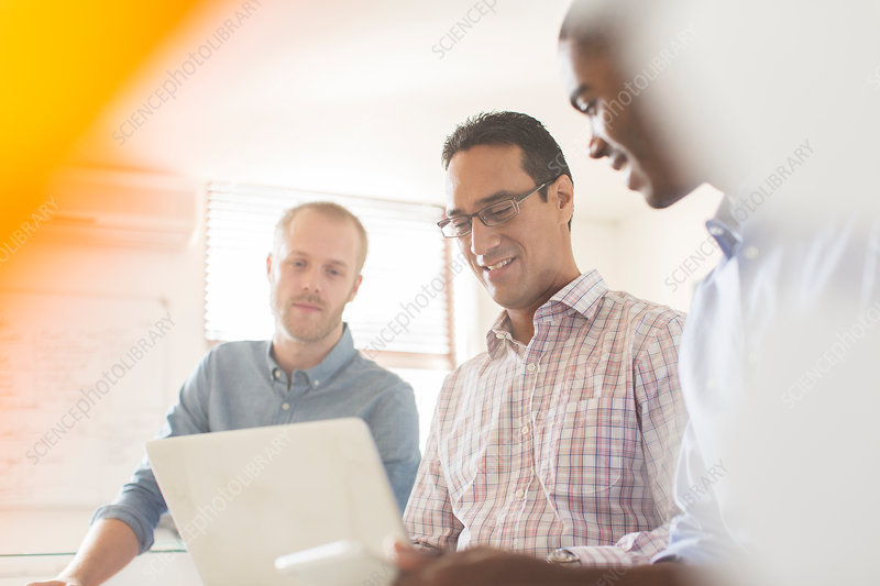 Businessmen working with laptop in office