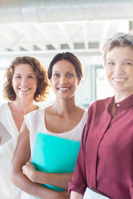 Portrait of three smiling businesswomen