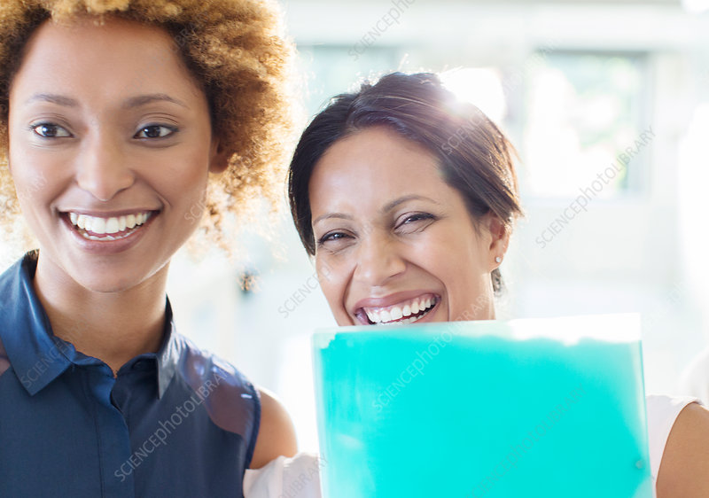 Portrait of two businesswomen laughing