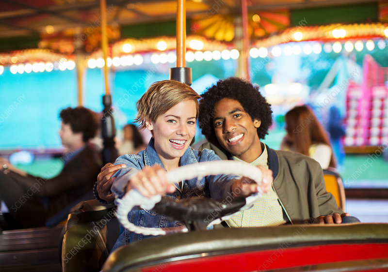 Young couple on bumper car ride