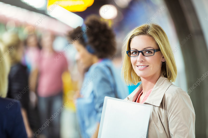 Businesswoman smiling in train station