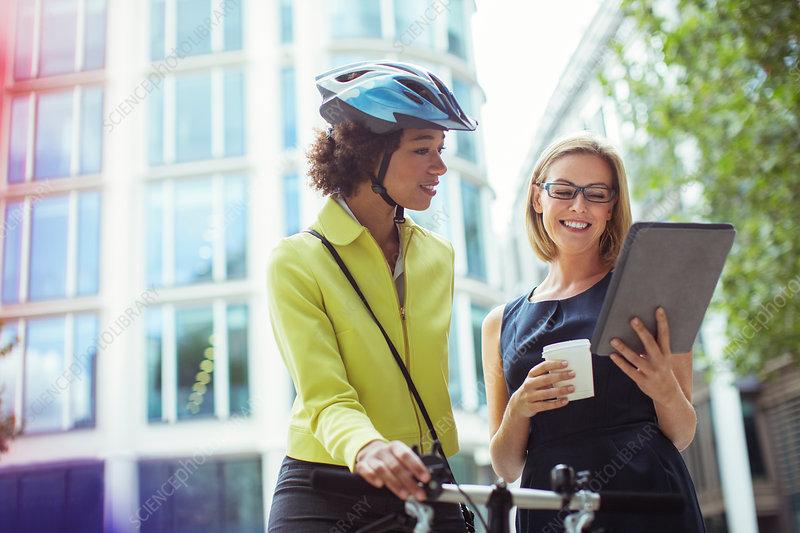 Businesswomen using tablet outdoors