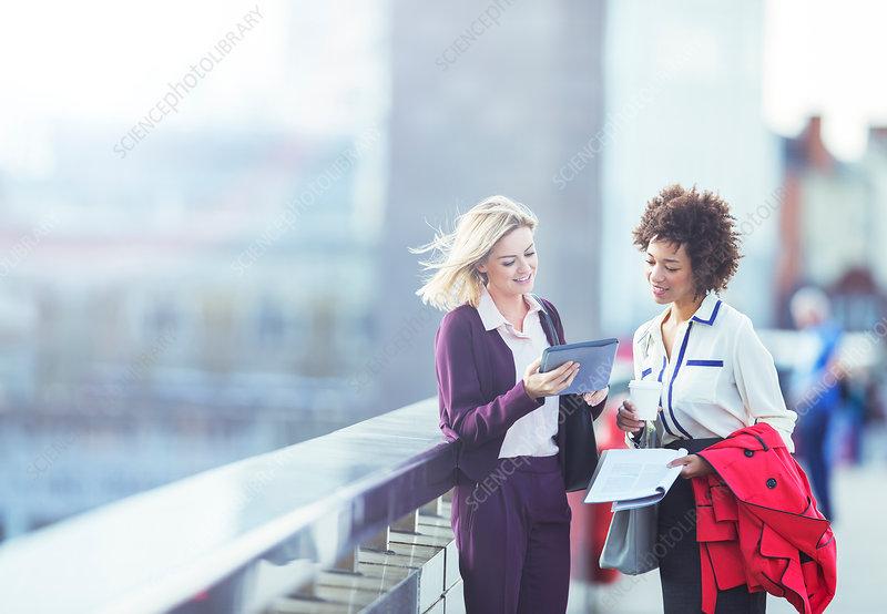 Businesswomen using tablet