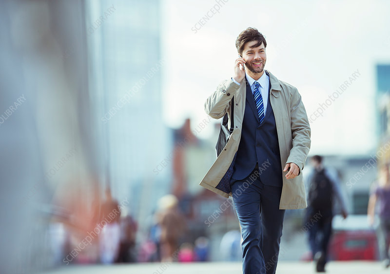 Businessman talking on cell phones