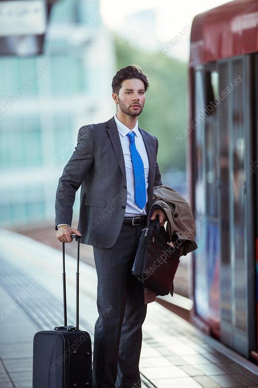 Businessman waiting at train station