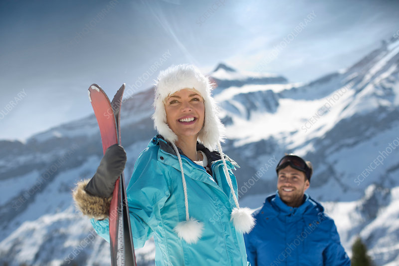 Couple with skis at mountain