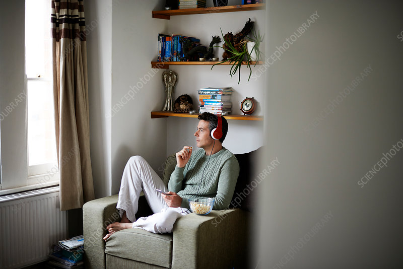 Man sitting in armchair