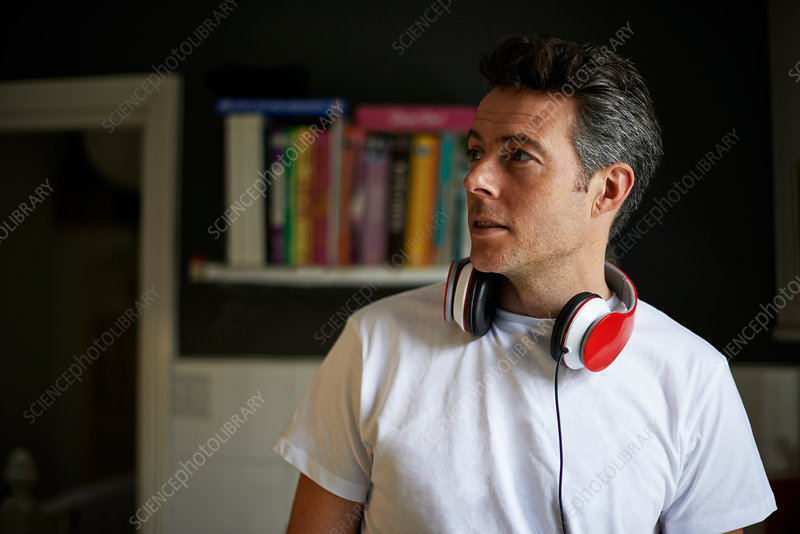 Man at home with red headphones