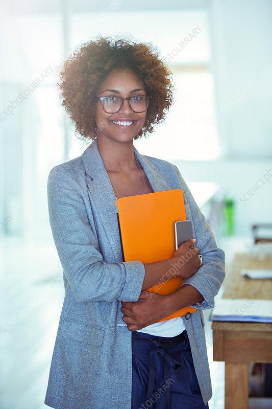 Office worker holding orange file