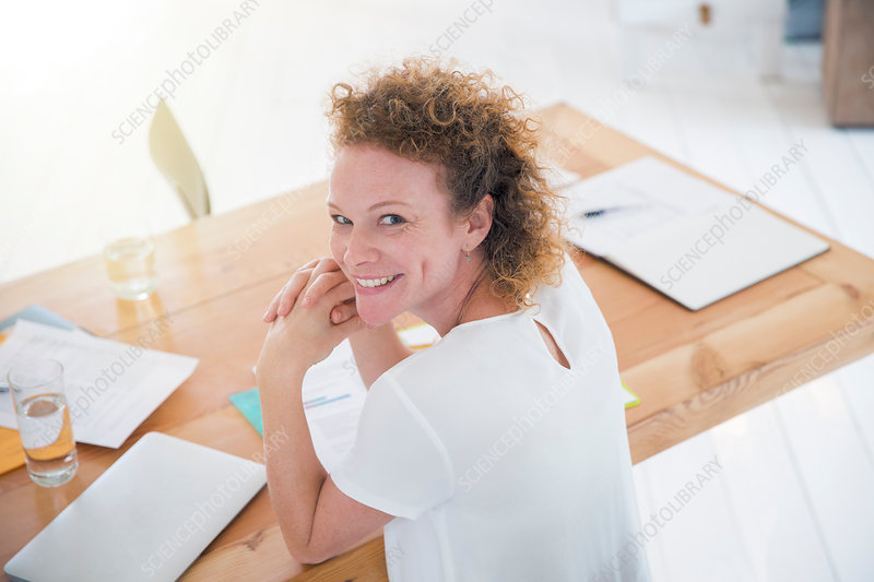 Portrait of young smiling office worker