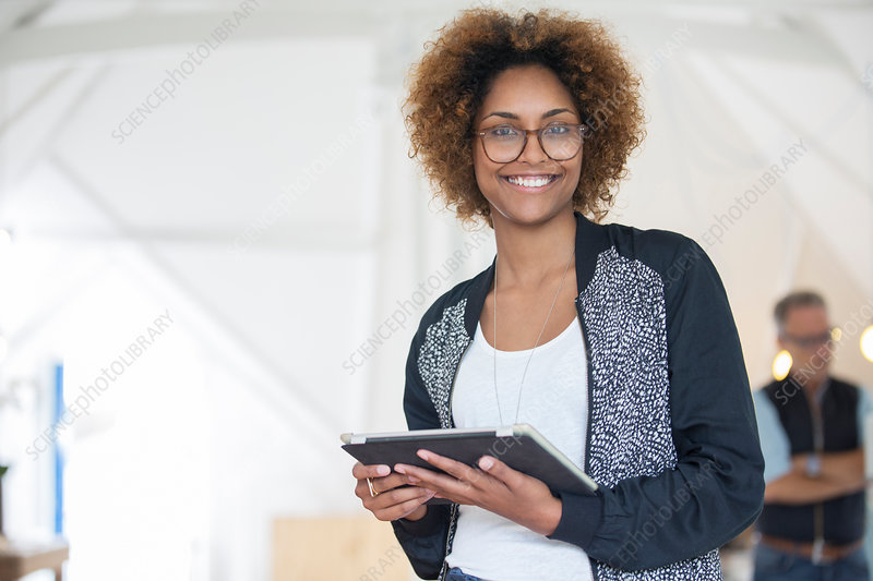 Office worker holding tablet