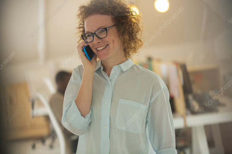 Portrait of woman talking on phone