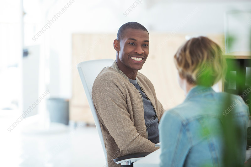 Man and woman sitting,smiling and talking