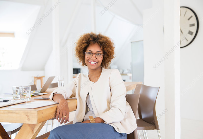 Woman sitting at desk and smiling
