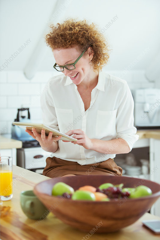 Woman sitting and looking at tablet