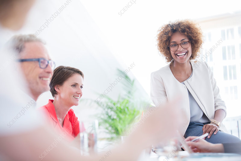 Office workers talking at desk