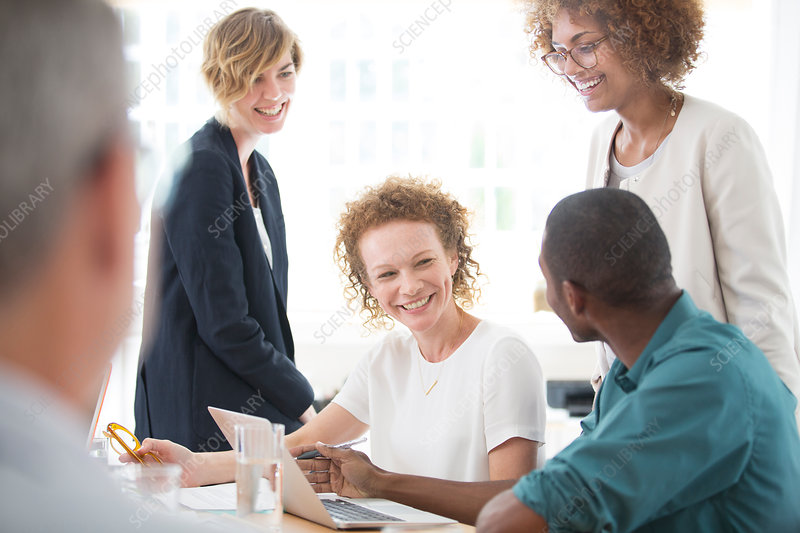 Group of office workers talking at desk