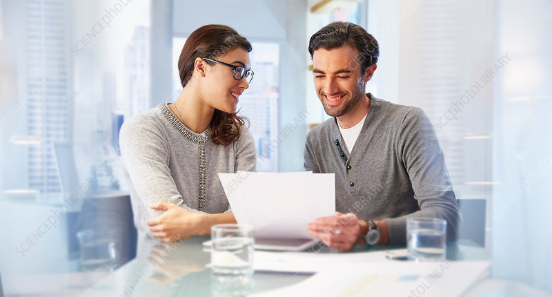 Man and woman working together in office